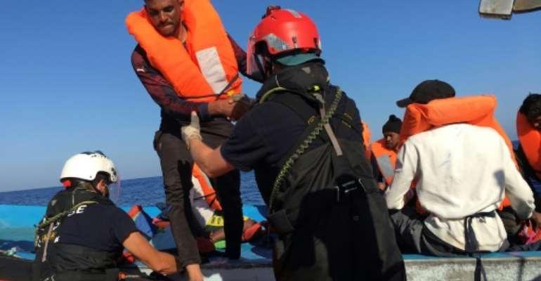 L'un des 47 migrants secourus par l'ONG SOS Méditerranée au large de l'île italienne de Lampedusa, le 30 juin 2020.  By Shahzad ABDUL (AFP)