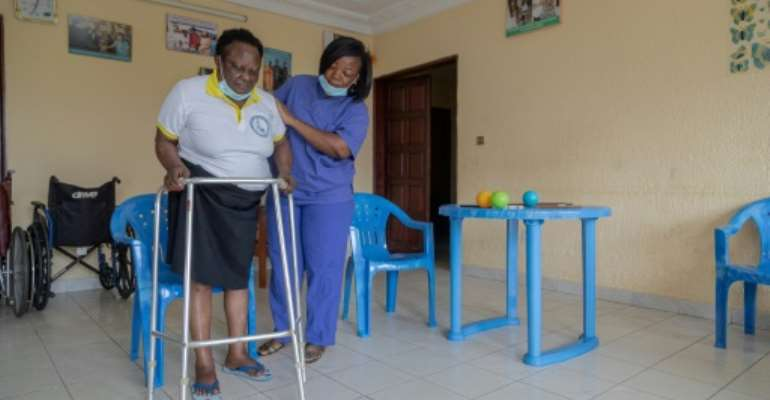 Lydie Ngapet, left, is one of eight people at the care home in Douala.  By Daniel Beloumou Olomo (AFP)