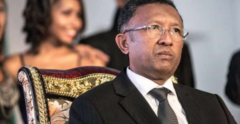 Madagascan President Hery Rajaonarimampianina came to power in 2013 elections, vowing to end years of turmoil after his predecessor Marc Ravalomanana was ousted in a coup in 2009.  By Rijasolo (AFP/File)