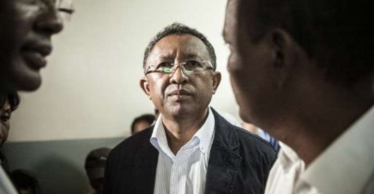 Madagascar's President Hery Rajaonarimampianina (C), pictured on January 24, 2014, defended himself through his lawyers, denouncing a recent vote to impeach him as an attempted