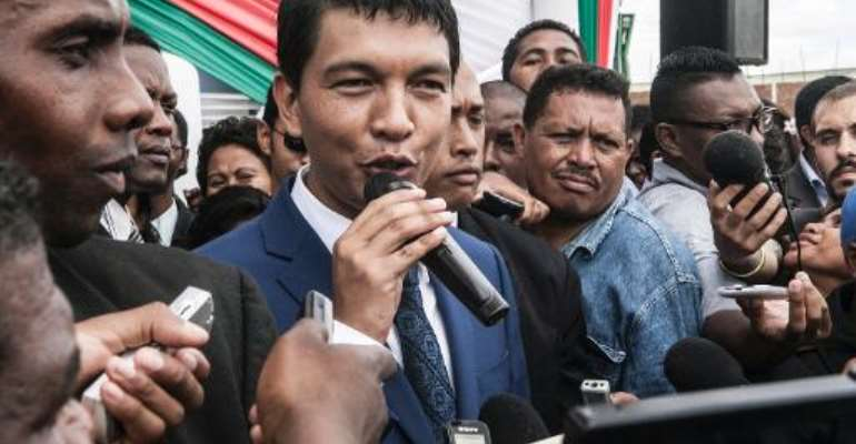 Andry Rajoelina (C), the transitional President of Madagascar, speaks about his political future as he addresses journalists during the inauguration of a hospital in Antananarivo on January 22, 2014.  By Rijasolo (AFP/File)