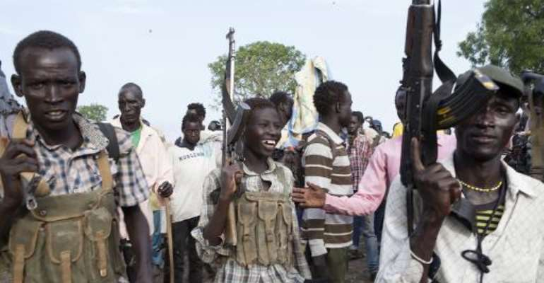 Members of the White Army, a South Sudanese anti-government militia, attend a rally in Nasir on April 14, 2014.  By Zacharias Abubeker (AFP/File)