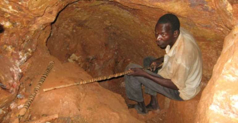 Makeshift gold miners often work in high-risk conditions where safety rules are ignored -- collapses of mining 'holes' are a big peril.  By FANNY PIGEAUD (AFP/File)