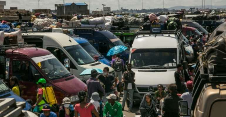 Malagasy rush to flee the capital after the government temporarily eased travel restrictions.  By RIJASOLO (AFP)
