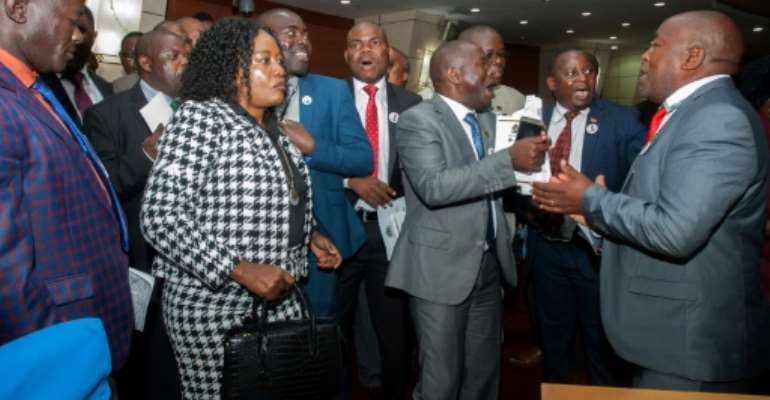 Malawi opposition members sang and danced as they sought to prevent President Peter Mutharika from delivering his state of the nation address..  By AMOS GUMULIRA (AFP)