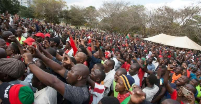 Malawi opposition supporters march to the parliament during a demonstration against the re-election of the president, which protestors say was due to fraud, on July 4, 2019, in Lilongwe, Malawi.  By AMOS GUMULIRA (AFP/File)