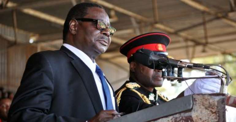 Newly elected Malawian President Arthur Peter Mutharika delivers a speech during his official inauguration as Malawi's new President, at the Kamuzu stadium in Blantyre on June 2, 2014.  By Amos Gumulira (AFP/File)
