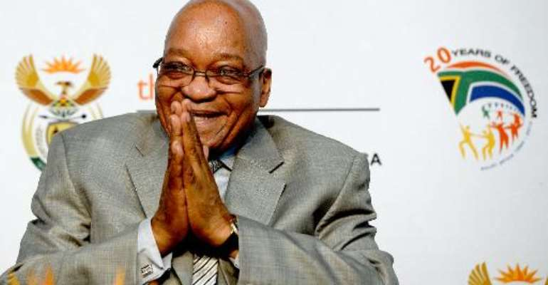 South Africa President Jacob Zuma gestures during the opening ceremony of the first national Broad-Based Black Economic Empowerment (B-BBEE) summit in Midrand on October 3, 2013.  By Stephane de Sakutin (AFP/File)