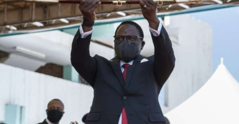 Malawi's new President Lazarus Chakwera shows the sword of office.  By AMOS GUMULIRA (AFP)