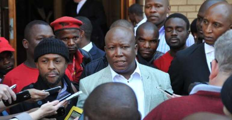 South African Economic Freedom Fighters party leader Julius Malema (C) addresses the media outside the North Gauteng High Court in Pretoria on August 25, 2014.  By Stefan Heunis (AFP/File)