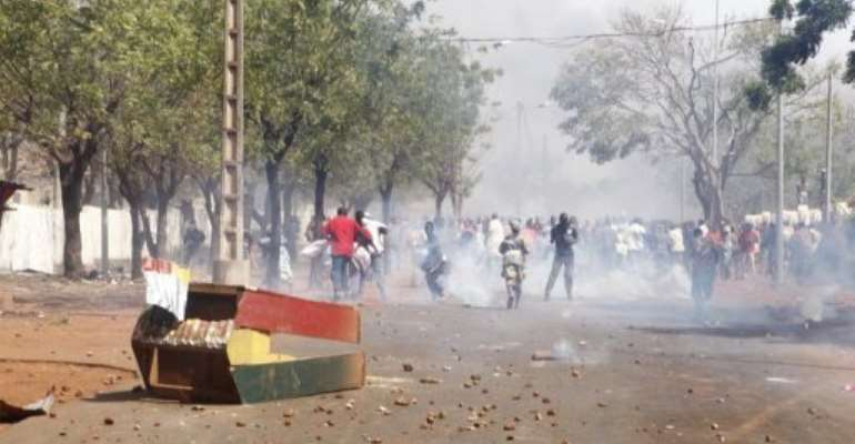 Supporters of Malian soldiers fighting Tuareg rebels, clash with security forces during a protest.  By  (AFP/File)