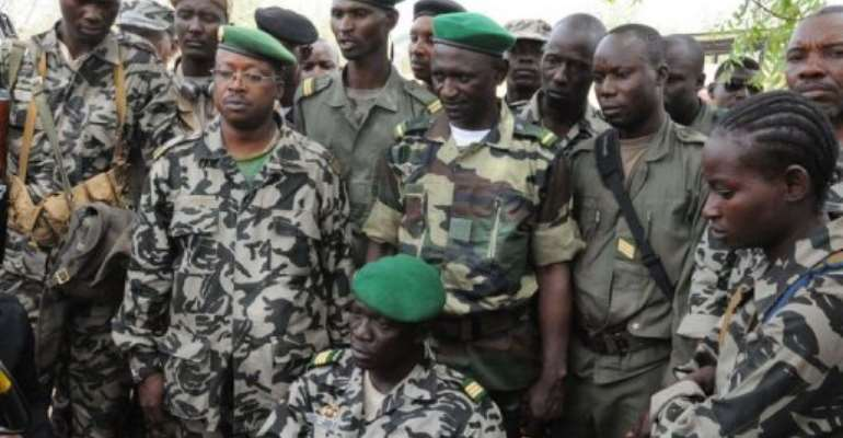 Mali junta leader Captain Amadou Sanogo (C) poses surrounded by his fellow soldiers.  By Habibou Kouyate (AFP/File)