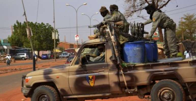 Soldiers from Chad leave Niamey for the Malian border on January 26, 2013.  By Boureima Hama (AFP)