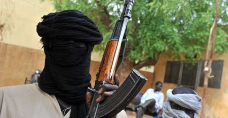 Islamist fighters in the courtyard of the Islamist police station in Gao, northern Mali, on July 16, 2012.  By Issouf Sanogo (AFP/File)