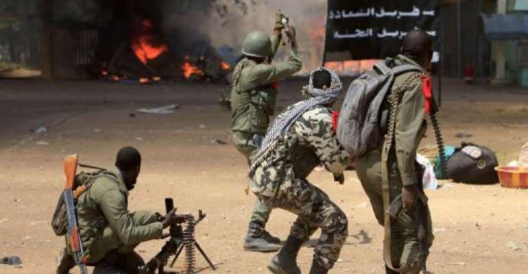 Malian soldiers fight in the city of Gao on February 21, 2013.  By Frederic Lafargue (AFP/File)