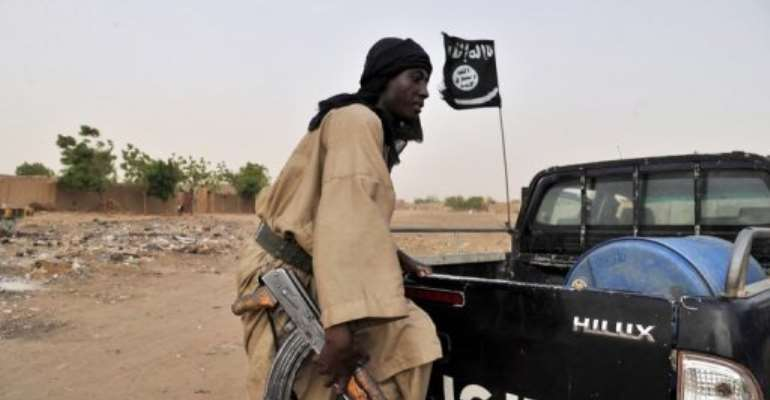 A fighter of an Islamist group MUJAO patrols on July 16, 2012 in Gao, northern Mali.  By Issouf Sanogo (AFP/File)