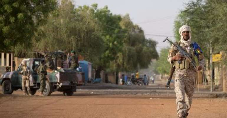 A file photo shows a Malian soldier on patrol in Gao, on April 13, 2013.  By Joel Saget (AFP/File)