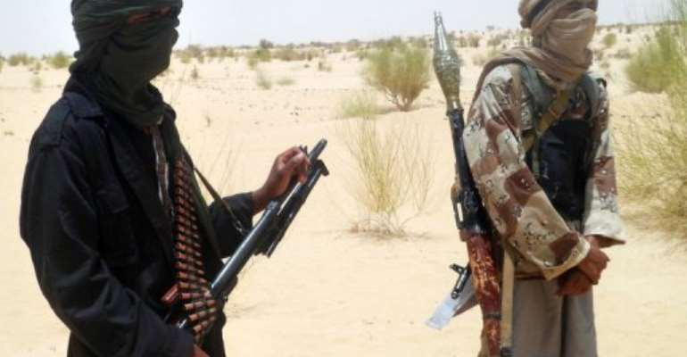 Islamist rebels of Ansar Dine near Timbuktu.  By Romaric Ollo Hien (AFP/File)