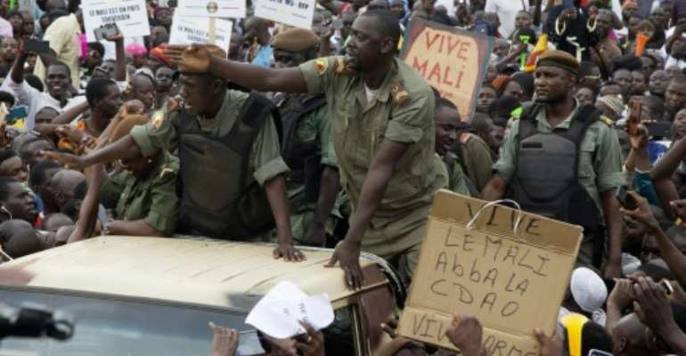 Malian demonstrators on Friday hailed soldiers for the military overthrow of President Ibrahim Boubacar Keita.  By ANNIE RISEMBERG (AFP/File)