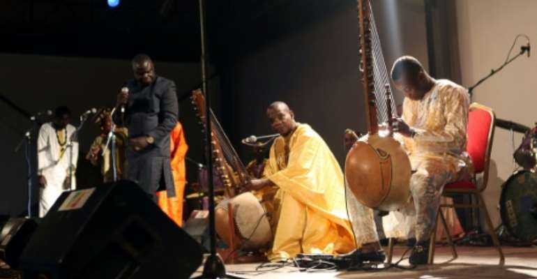 Malian kora players with an instrument similar the one played by Sissoko.  By SÉBASTIEN RIEUSSEC (AFP)