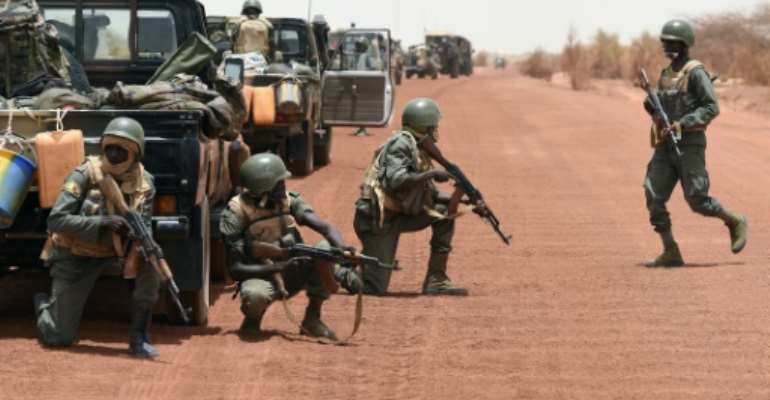 Malian soldiers on June 2, 2015 securing the pist between Goundam and Timbuktu, an area which has seen a strong resurgence of violence in the past few days.  By Phillippe Desmazes (AFP/File)