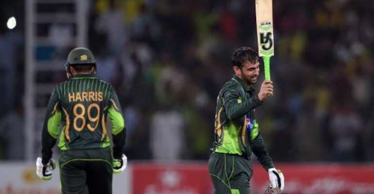 Pakistan's Shoaib Malik celebrates after reaching his century against Zimbabwe on May 26, 2015.  By Aamir Qureshi (AFP)