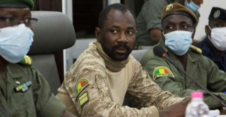 Mali's junta leader, Colonel Assimi Goita, has vowed to install an 18-month transition government.  By ANNIE RISEMBERG (AFP/File)