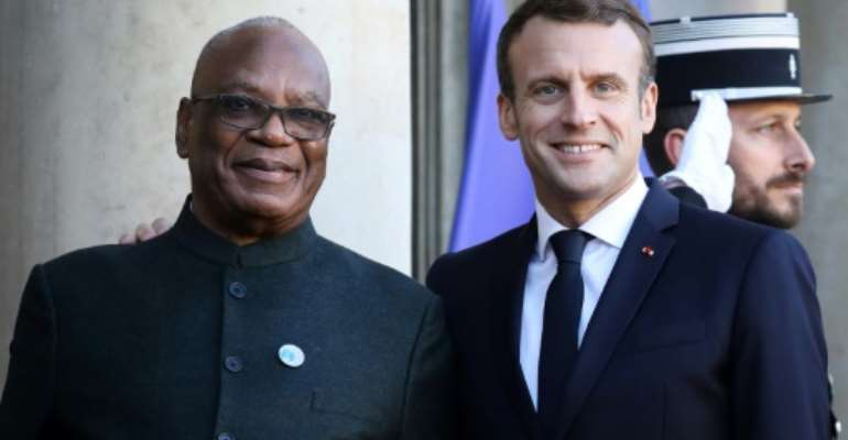 Mali's leader Ibrahim Boubacar Keita, seen here with French President Emmanuel Macron, has urged Malians against hostility to foreign forces in the country.  By LUDOVIC MARIN (AFP)