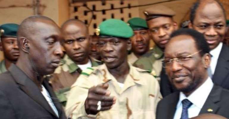 Mali's speaker of parliament Dioncounda Traore (R) stands next to Captain Amadou Sanogo (C).  By Habibou Kouyate (AFP/File)