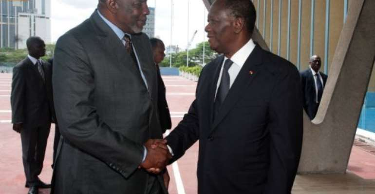 The prime minister of Mali's transition government Cheick Modibo Diarra (left) meets Ivorian President Alassane Ouattara.  By Herve Sevi (AFP)