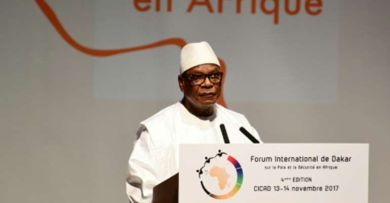 Mali's president Ibrahim Boubacar Keita said the new amnesty law would draw on a so-called charter for peace, unity and national reconciliation, which he received in June.  By SEYLLOU (AFP/File)
