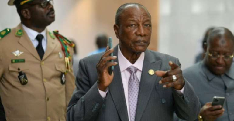 Man in a hurry: Guinean President Alpha Conde, centre, at an African Union summit in Addis Ababa this month.  By Michael TEWELDE (AFP)