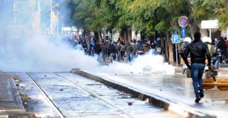 Police fire tear gas to disperse protesters on Habib Bourguiba Avenue in Tunis on February 8, 2013.  By Salah Habibi (AFP/File)