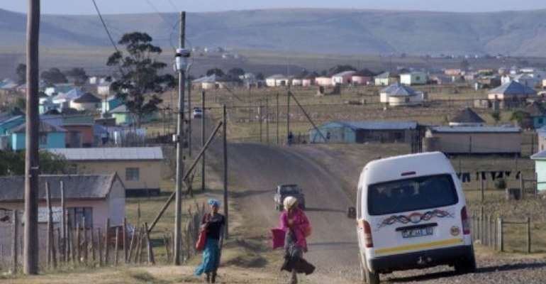 A road through the village of Qunu, South Africa, where Mandela grew up.  By Rodger Bosch (AFP/File)