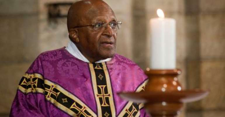Archbishop Emeritus Desmond Tutu leads a service in St. George's Cathedral on December 6, 2013, after the anouncement of the death of Nelson Mandela, in Cape Town.  By Rodger Bosch (AFP/File)