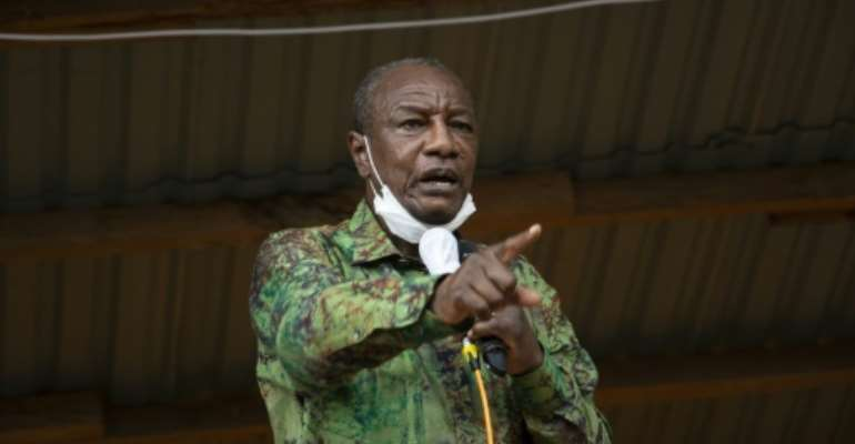 Many are divided over Guinea President Alpha Conde's economic successes before Sunday's vote.  By CAROL VALADE (AFP)