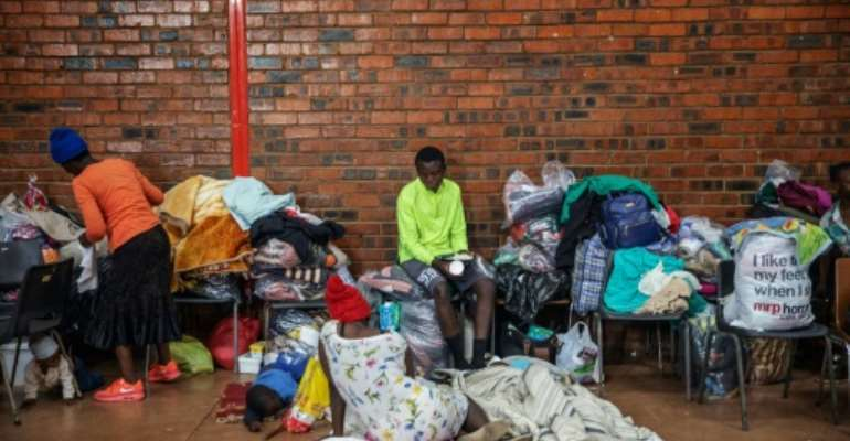 Many foreigners fled the violence with the few belongings they could grab during the Johannesburg attacks.  By Michele Spatari (AFP)