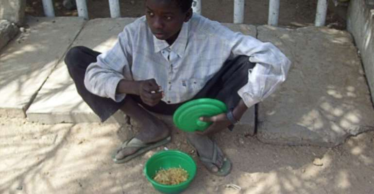 Many street children in the northern Nigerian city of Kano are enrolled in informal Islamic schools which force youngsters to beg, say critics.  By AMINU ABUBAKAR (AFP/File)