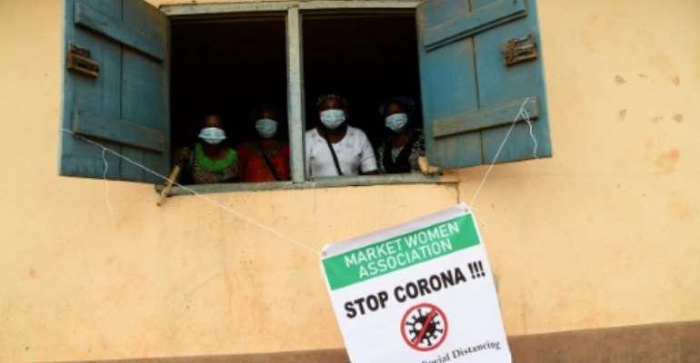 Market traders underwent anti-coronavirus training to prepare for the lifting of the lockdown.  By PIUS UTOMI EKPEI (AFP)
