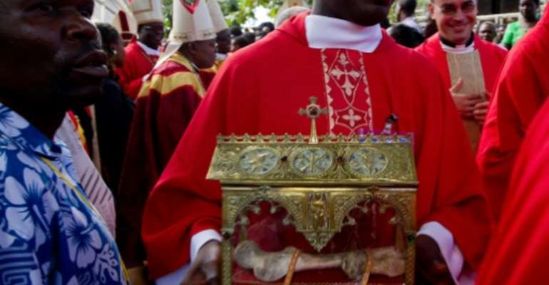 Martyrs Day commemorates 45 Anglican and Catholic converts to Christianity who were killed in the 1880s by Mwanga II, the king of Buganda, now part of Uganda. A bone of one of the martys is a revered relic.  By MARC HOFER (AFP/File)