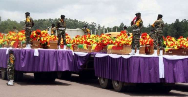 The coffins of 145 victims were draped in the national flag.  By Junior D. Kannah (AFP)