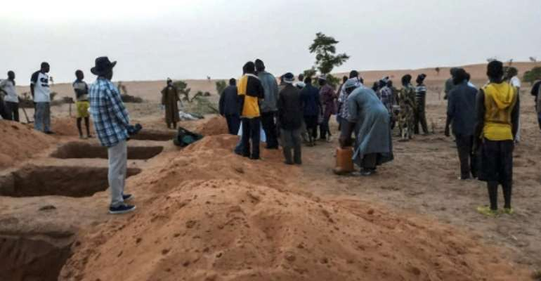 Mass graves were dug for victims of Sunday's attack, the latest episode of bloodshed in central Mali.  By STRINGER (AFP)