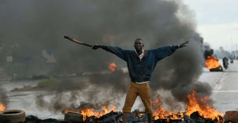 Mass protests supported by the army ended the September 2015 attempted coup.  By SIA KAMBOU (AFP/File)