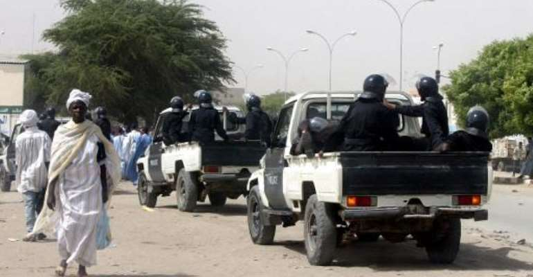 Police forces patrol the streets of Nouakchott, Mauritania on November 5, 2003.  By Georges Gobet (AFP/File)