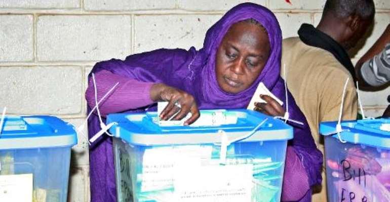 A woman casts her vote at the Ksar polling station in Nouakchott on November 23, 2013.  By Mohamed Ould Elhadj (AFP)