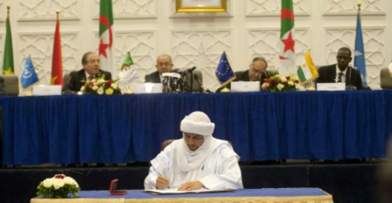 May 14 2015: The Malian government and rebel groups sign a peace accord in Algiers. But movement to implement the deal has been slow.  By FAROUK BATICHE (AFP)