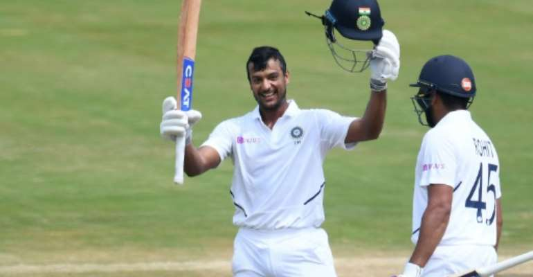 Mayank Agarwal raises his bat after reaching 100.  By NOAH SEELAM (AFP)