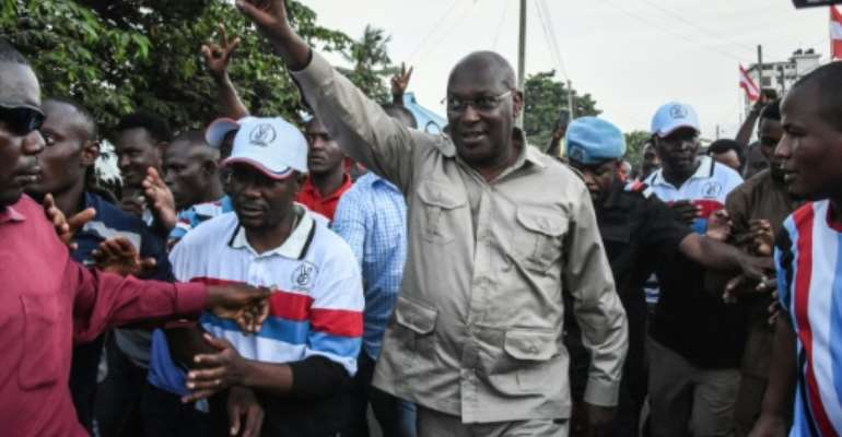 Mbowe, waving, was detained with 15 other party members in a late-night crackdown last week.  By Ericky BONIPHACE (AFP/File)