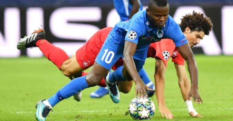 Mbwana Samatta, in the blue of Genk, scraps for possession in the Belgian side's defeat against Salzburg with which they began their Champions League campaign.  By JOE KLAMAR (AFP/File)