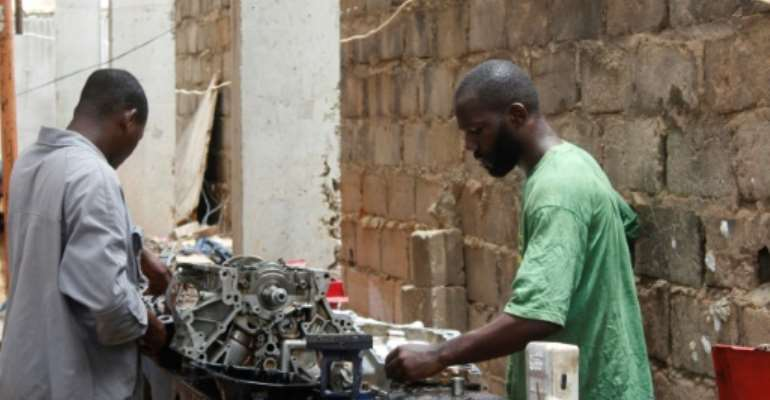 Mechanic Joao Pande, right, says corruption still permeated all levels of Angolan society.